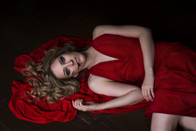 Beautiful Young Blonde Woman In Red Dress With Halloween Make Up And Bloody Face Art, Victim Of Domestic Violence