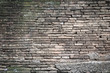 Brick wall texture pattern or brick wall background for interior or exterior design with copy space for text or image. Dark edged.