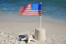 Sand Castle With American Flag On Beach