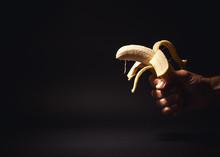 Male Hand Holding A Banana