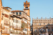 Buildings with Gardello tower on Erbe square in Verona city