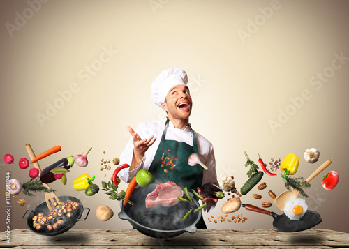 Foto op Canvas Koken Chef juggling with vegetables and other food in the kitchen