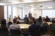 Businessman Making Presentation At Conference