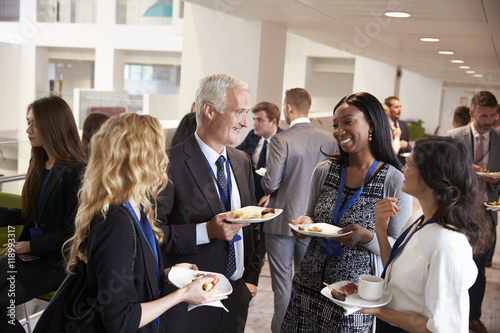 Photo Delegates Networking During Conference Lunch Break