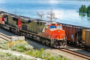 Power Diesel Engine Pulling a Cargo Train