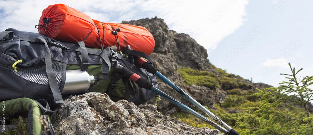Fototapety, obrazy: Mountain backpack,isoprene and trekking sticks equipment
