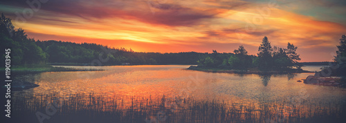Stickers pour portes Orange eclat Vivid golden sunset in the archipelago of Scandinavia. Evergreen