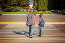 Two Boys With Backpack Walking, Holding On Warm Day  On The Road