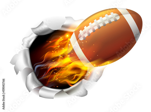 Photo  Flaming American Football Ball Tearing a Hole in the Background