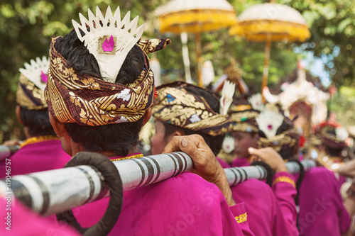 Fotografie, Obraz  Group of Balinese men in ethnic costumes -  musicians of traditional ceremonial Baleganjur orchestra
