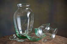 Broken Glass Vase On Old Wood Table