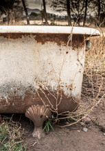 Weathered, Rusty Old Bath Tub Outside