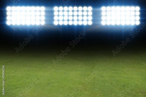 Foto op Plexiglas Stadion Green soccer field, bright spotlights