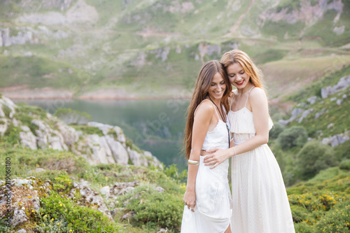 Happy best friends in white clothes against of natural background