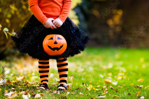 Little girl having fun on Halloween trick or treat