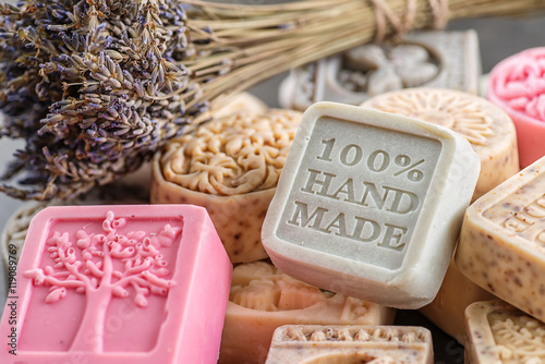 Fotografie, Obraz  set of handmade soaps with lavender bunch, product of cosmetics and body care