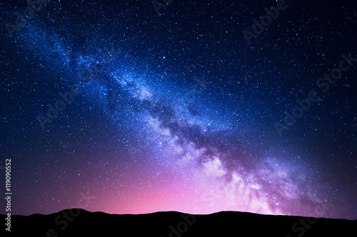 Cadres-photo bureau Noir Milky Way and pink light at mountains. Night colorful landscape.