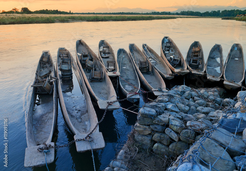 Wall Murals Nepal Boats on the mooring in Chitvan's national park in Nepal.