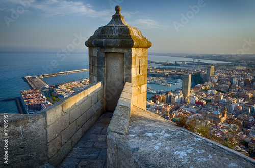 Small tower on the steep of Santa Barbara castle in sunlight, Alicante, Spain Fotobehang