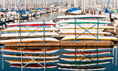 Foto op Aluminium Water Motor sporten Colorful Kayaks Stacked on a Pier at a Marina north of Seattle and Reflected in the Water