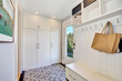 canvas print picture - White hallway interior.  Storage cabinet with hangers