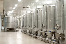 Modern Stainless Steel Wine Reservoirs  In A Row Inside The Mode