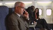 Business passenger on cellphone