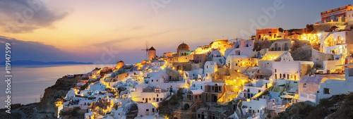 Fotografia, Obraz  Panoramic view of Oia at sunset