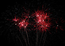 Bright Red Fireworks Light The Sky
