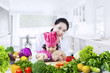 Pretty girl learns to prepare vegetables