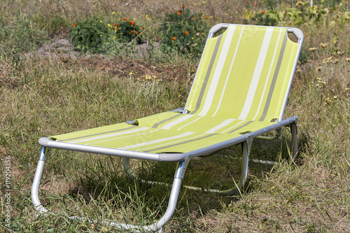 Fotografija  relaxing chair ready to use on grass