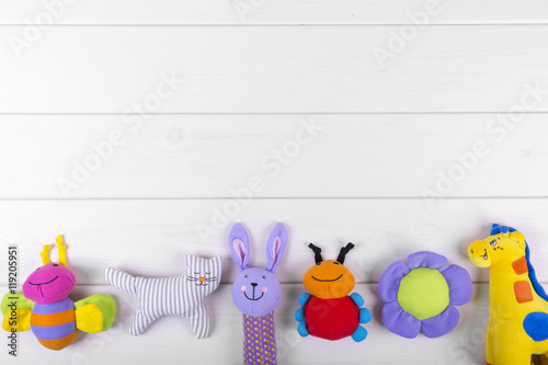 Fotografie, Obraz  stuffed baby toys on wooden background with copy space
