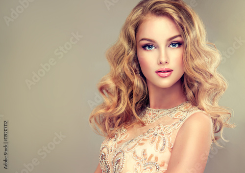 Fotografie, Obraz  Young beautiful woman, dressed in evening gown
