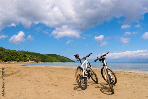 Foto op Plexiglas Two bicycles on the beach. Corfu island. Greece.