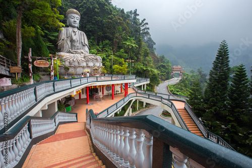 Photo Stands Kuala Lumpur Genting Highlands, Malaysia - AUGUST 19, 2016: Large stone Buddha statue at Chin Swee Caves Temple in Genting Highlands, Pahang, Malaysia