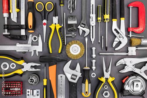 Fototapeta set of hand various work tools on grey background top view obraz