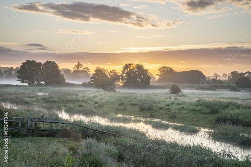 Printed kitchen splashbacks Khaki Beautiful vibrant Summer sunrise over English countryside landsc