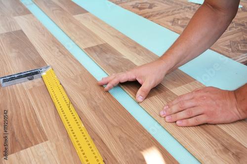 Man Laying Laminate Flooring Installing Wooden Laminate