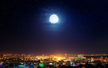 City Landscape At Nigh With Moon. Elements Of This Image Furnished By NASA.