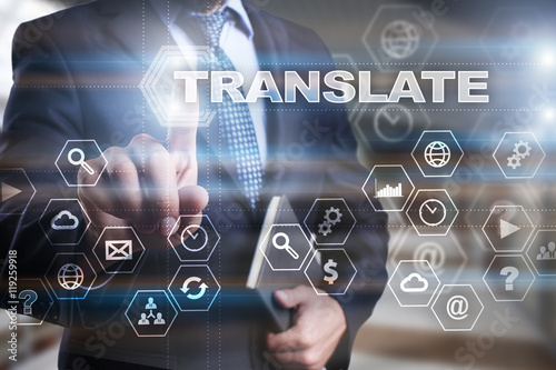 """Fotografía  Businessman is pressing on the virtual screen and selecting """"Translate"""""""