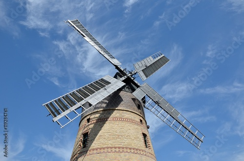 Poster Molens old wind mill blue cloudy sky