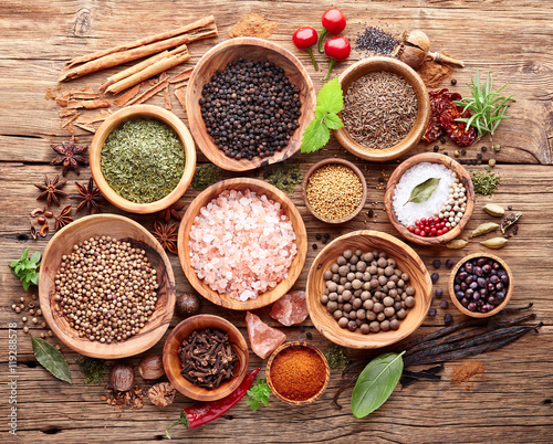 Herbs and spices on a wooden board - 119288578