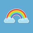Rainbow and clouds sticker isolated on blue background. Nature sign cloud rainbow spectrum. Weather curve icon, graphic abstract symbol.