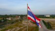 Aerial view , Thai flag blowing in the wind on sky