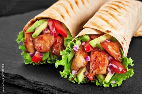 Fotobehang Kip Burrito with grilled chicken and vegetables (fajitas, pita bread