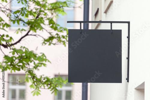 Fotografía  Black empty outdoor signage mockup to add company logo