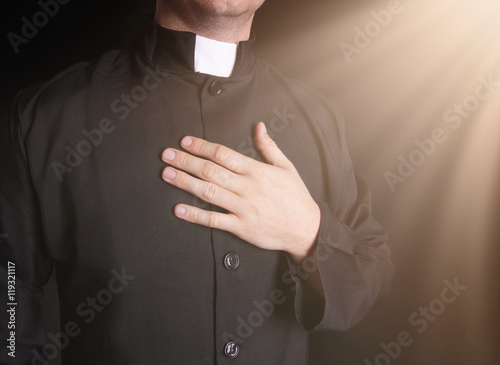 Canvas Print Praying priest