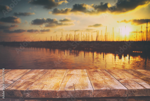 table in front of abstract blurred background of marine