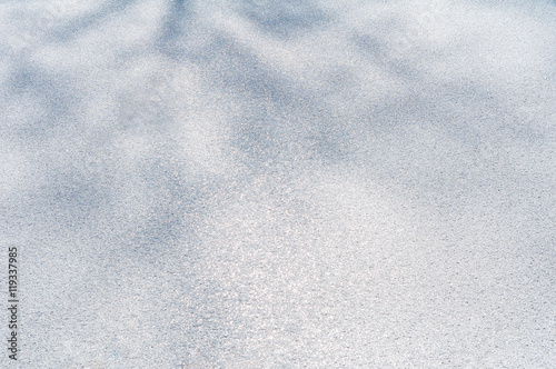 Papiers peints Arctique White snow ice frost winter surface abstract texture background light shadow tree branch ground