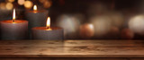 Wooden table with candles background